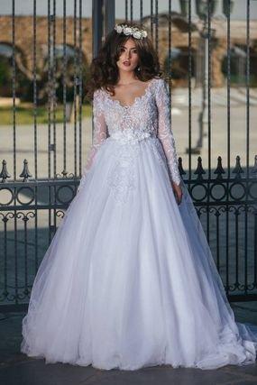 فستان زفاف باكمام طويلة