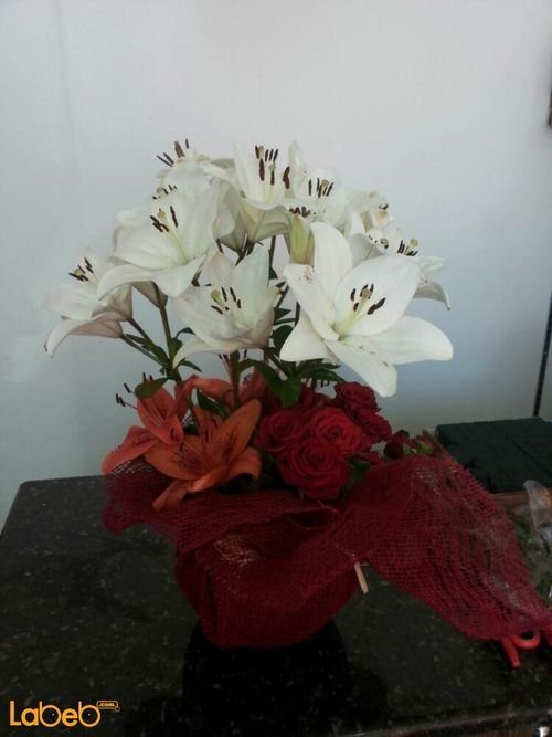 Flowers bouquet with glass base from lilium rode flowers