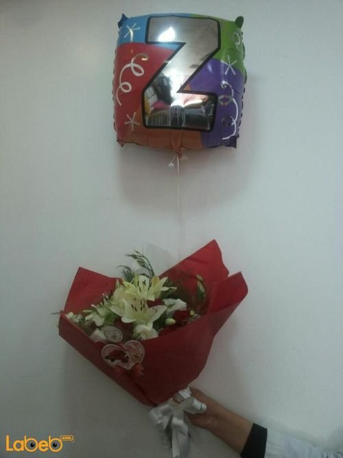 Flower bouquet from lilium red rose white louisiana with helium balloon