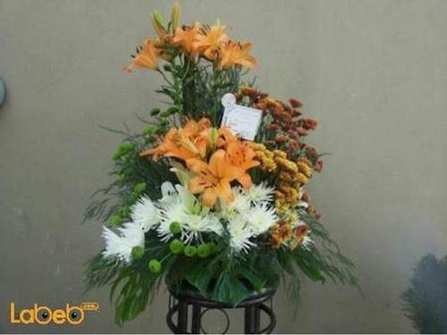 بوكية ازهار زهرة ليليوم زهرة كريز نبتة القفص الصدري برتقالي ابيض اخضر