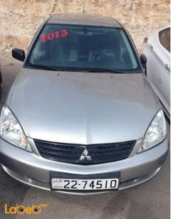 Mitsubishi Lancer 2013 - Engine Capacity 1300 - silver color - 65000km