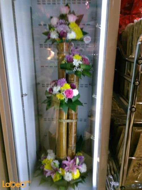 Wooden stand with Natural flowers Pink Yellow White and Red