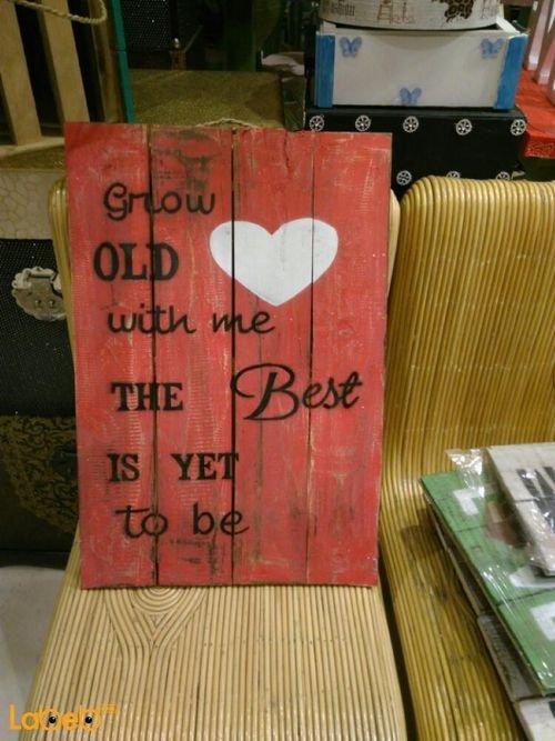 حائط خشبي أحمر مع كتابة Grow OLD with me The Best IS YET to be لون أسود