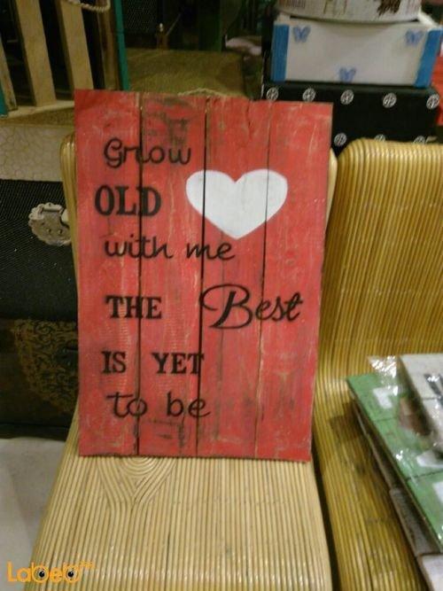 حائط خشبي أحمر مع كتابة Grow OLD with me The Best IS YET to be