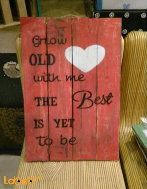 حائط خشبي لون أحمر مع كتابة Grow OLD with me The Best IS YET to be
