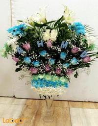مزهرية وفازة زجاجية ورد طبيعي ورد ابيض وازرق وبنفسجي