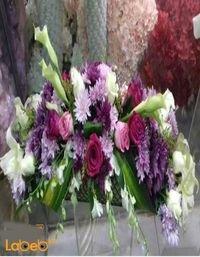 بوكيه ورد طبيعي لتزيين الطاولة ألوان ابيض زهري بنفسجي