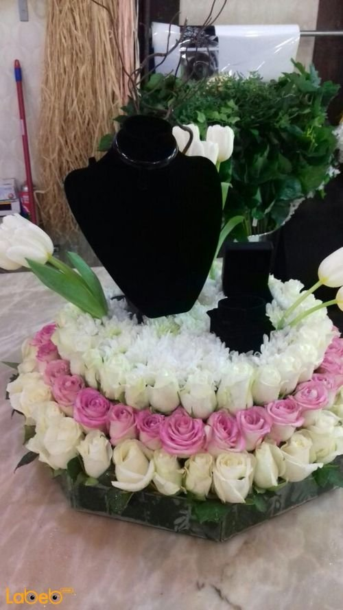 Natural flowers bouquet with wedding Jewelry pink and white colors