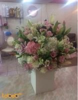 Natural flowers bouquet with wooden base Several colours
