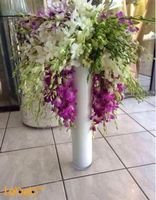 Natural flowers bouquet with white vase Purple white & green colors