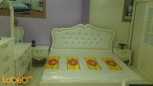 غرفة نوم من 7 قطع خشب ماليزي لون اوف وايت سرير بمقاس 2*2 متر