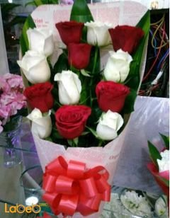 Natural Roses bouquet - white and red - green leaves in background