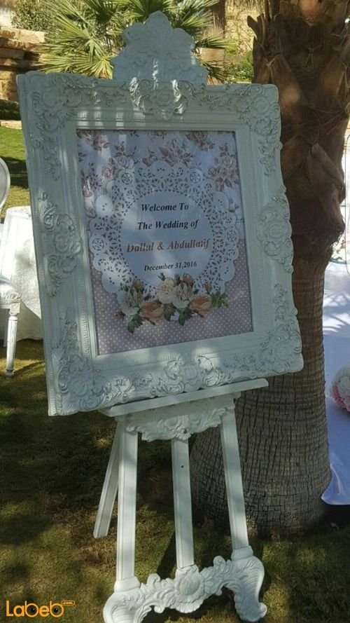 Frame with stand with natural and artificial flowers and Printed words