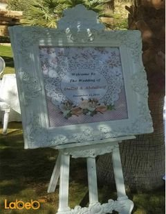 Frame with stand - with natural and artificial flowers