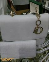 Christian Dior bag gray color with wallet golden accessory