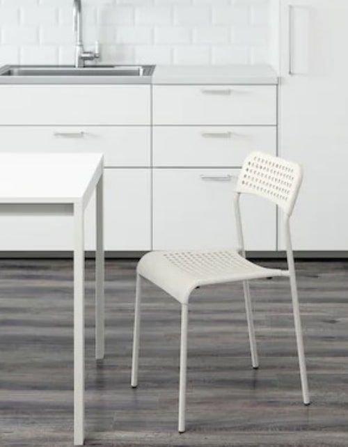 كرسي طعام ADDE من إيكيا، مقعد بلاستيك، أرجل فولاذ، لون أبيض